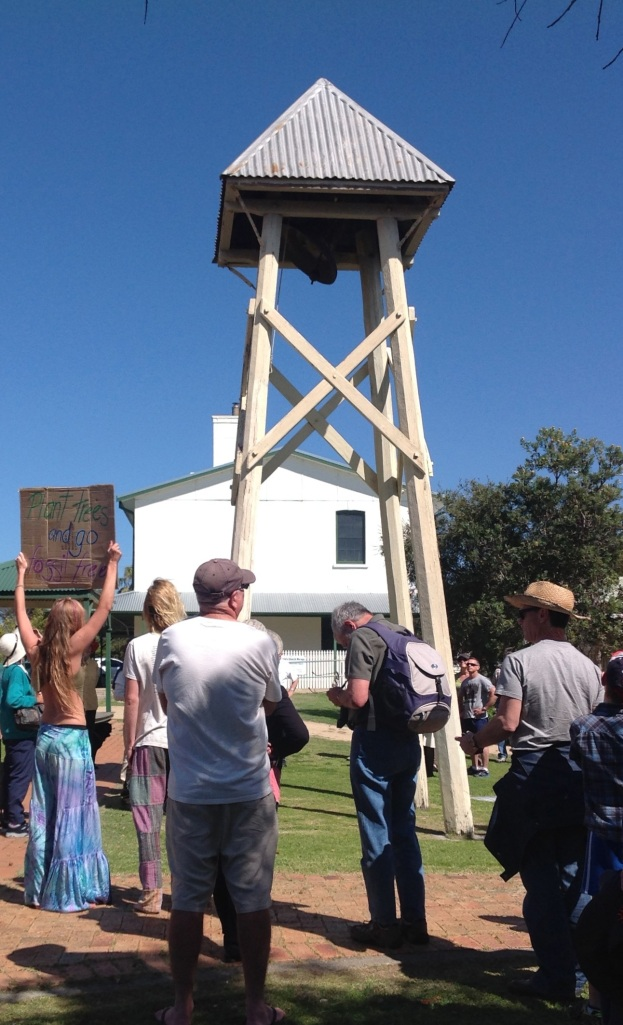 Ringing the Church Bell and celebrating the Anglican Church divesting its fossil fuel holdings at the Moruya Climate Action Picnic